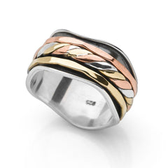 A wavy 925 sterling silver band, wrapped with bands of twisted silver, brass and copper which move freely spin ring