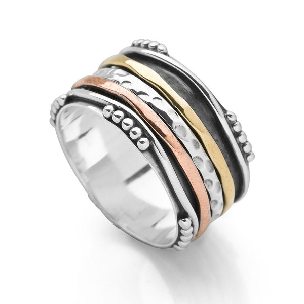 925 sterling silver spin ring with bands of copper, brass and silver with hammered and oxidised detailing