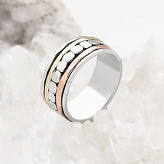 925 sterling silver spin ring with bands of silver, copper and brass plating. (R19931)