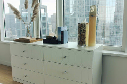 An image of the same IKEA malm dresser with new drawer fronts and knobs