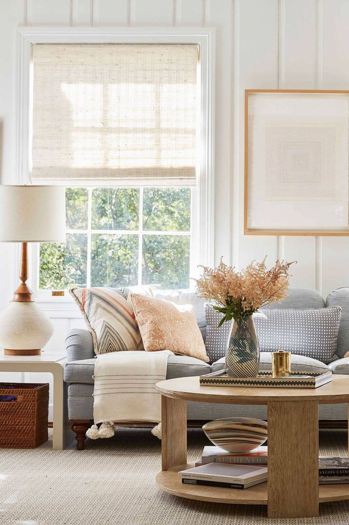Natural lighting in a living room with a neutral color palette.
