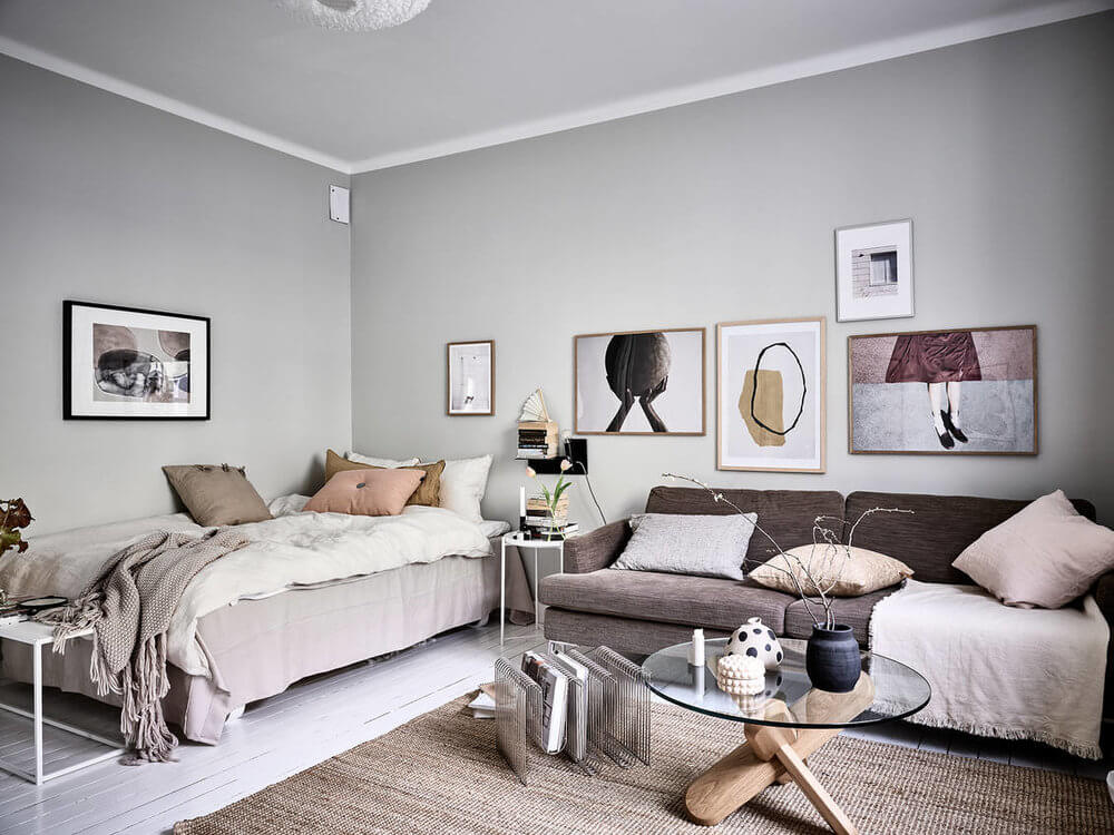 Small but stylish studio apartment with a neutral feminine color palette