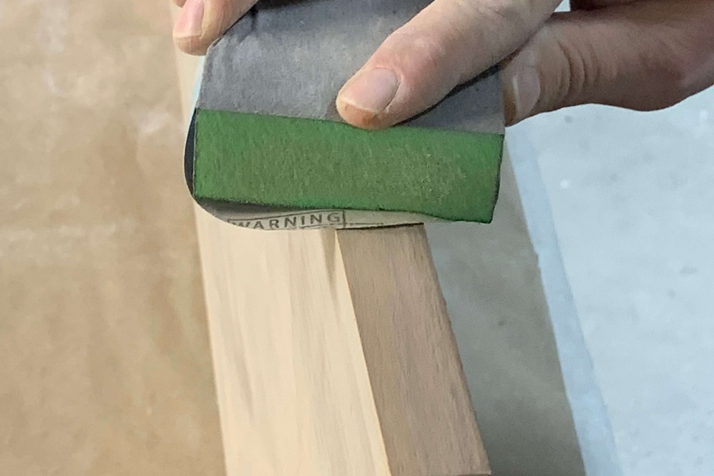 Sanding and prepping the wood doors