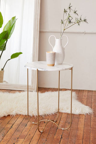 Circular marble patterned side table with metal legs