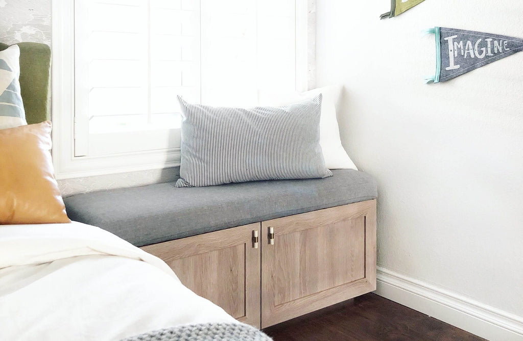 IKEA Besta cabinet used as bench with a cushion and pillows