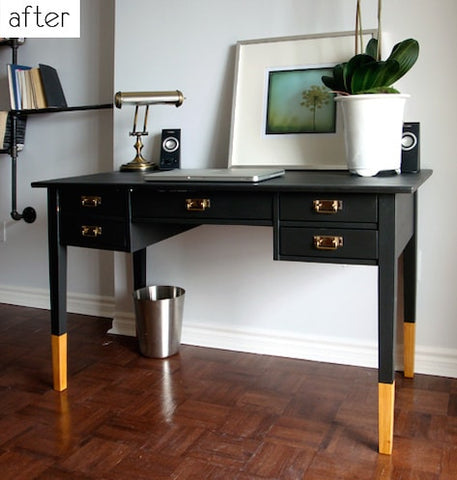 A black painted desk with dip dye yellow legs