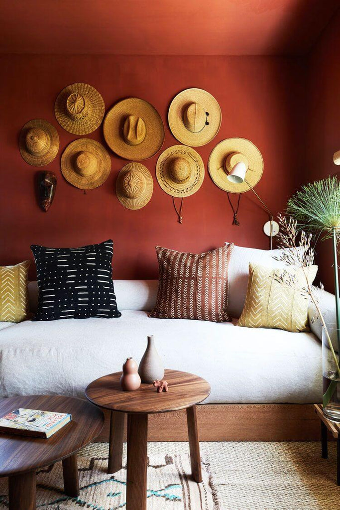 Boho style living room with a bold decorated wall.