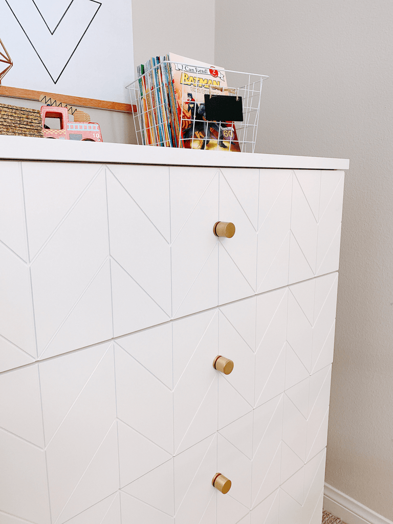 Norse Interior's brass Elisabeth knobs with Eleanor drawer fronts on a Malm dresser from IKEA.