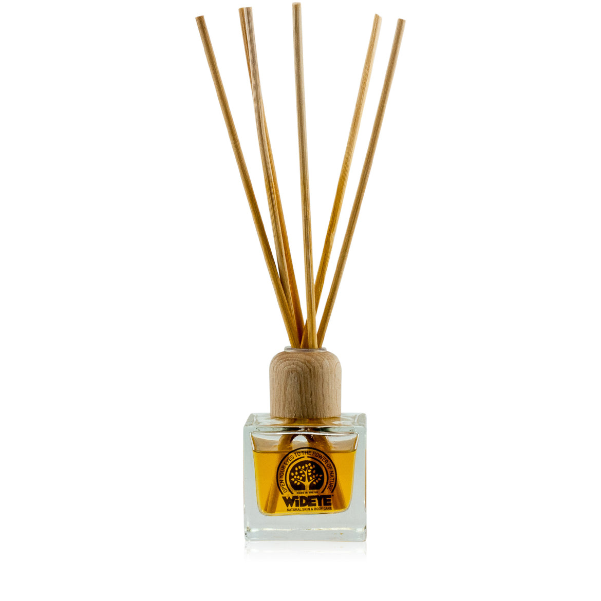 Natural aromatherapy essential oil 'Beach Bum' reed diffuser in glass bottle made by WiDEYE in Rye.