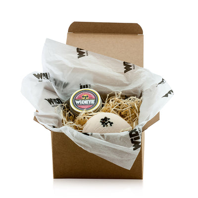 Natural skincare 'Muscle Management' gift box including a muscle management active balm and a muscle management bath bomb. Handmade by WiDEYE in Rye.