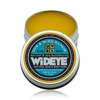 Natural vegetarian skincare Sun and Wind balm in an aluminium tin with lid removed, handmade by WiDEYE in Rye.