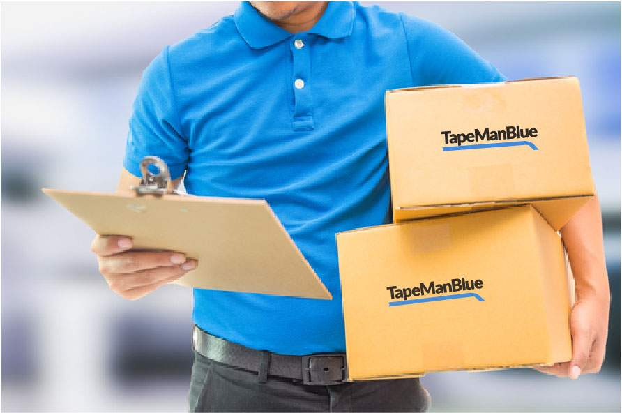 man carrying boxes of TapeManBlue tape