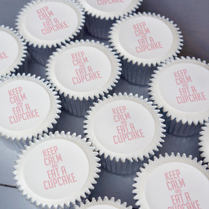 "Cupcakes with ""Keep Calm and eat a cupcake"" printed on top in pink"