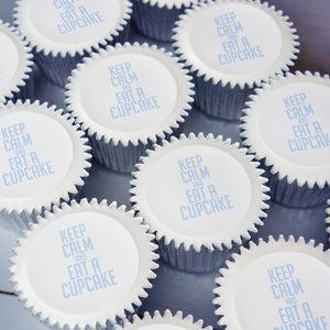 "Cupcakes with ""Keep Calm and eat a cupcake"" printed on top in blue"