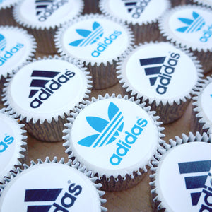 Branded logo cupcakes. Each cupcake has an edible logo printed topper.