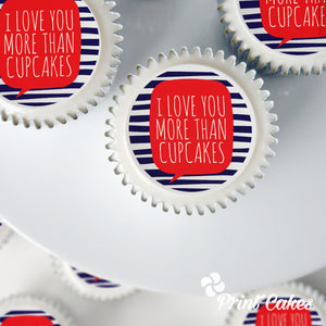 "Valentine cupcakes with ""Love you more than cupcakes."" printed on top."