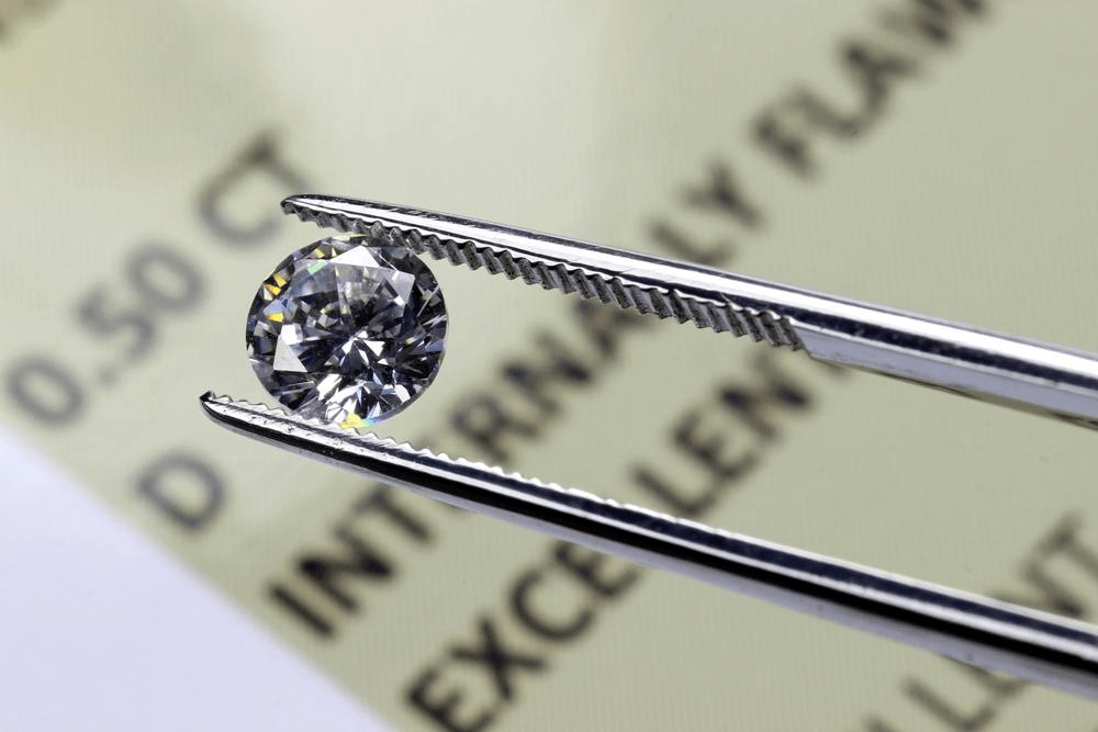 A diamond is closely inspected to determine its clarity rating