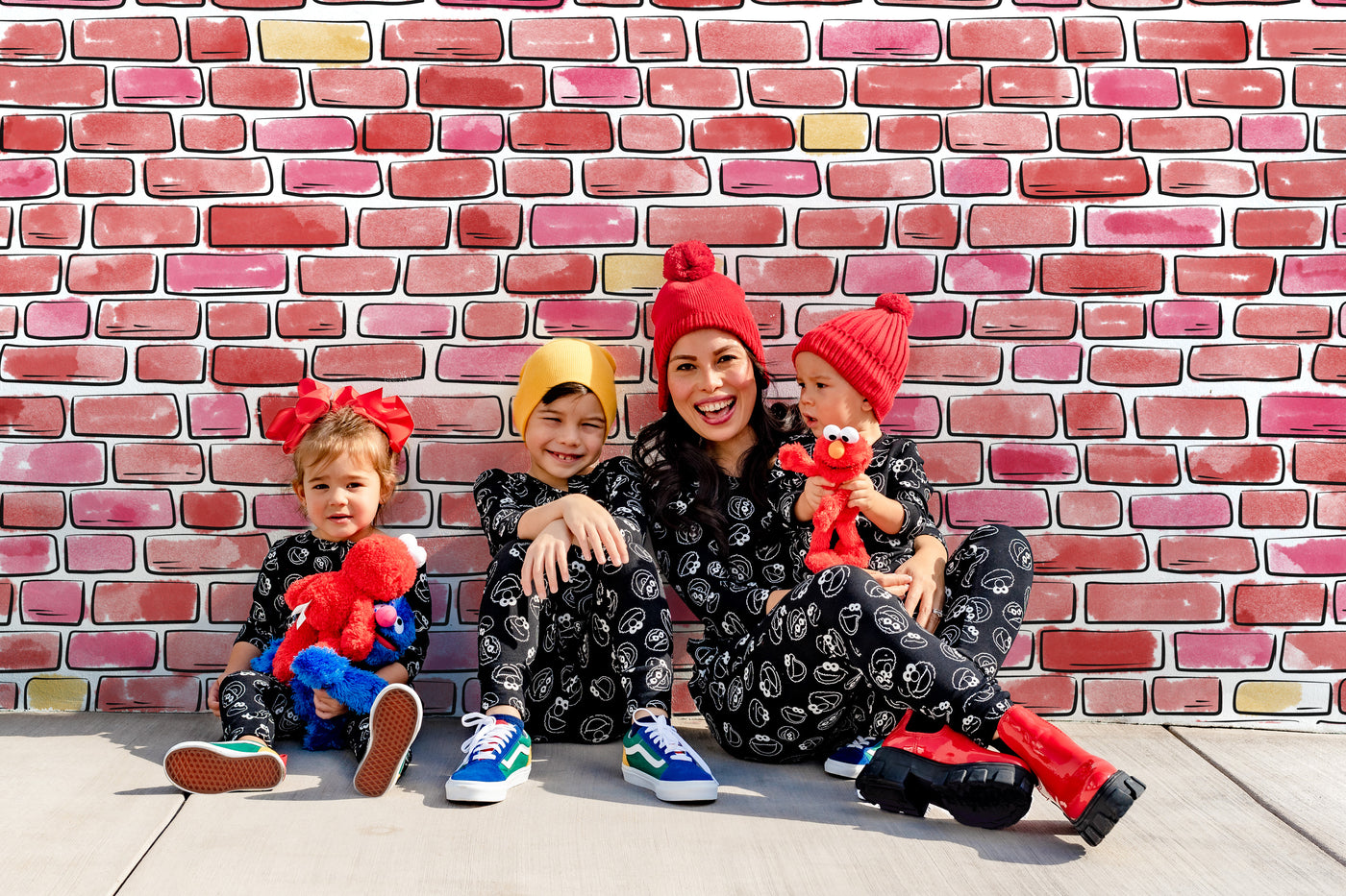 family wearing sesame street x smash + tess rompers