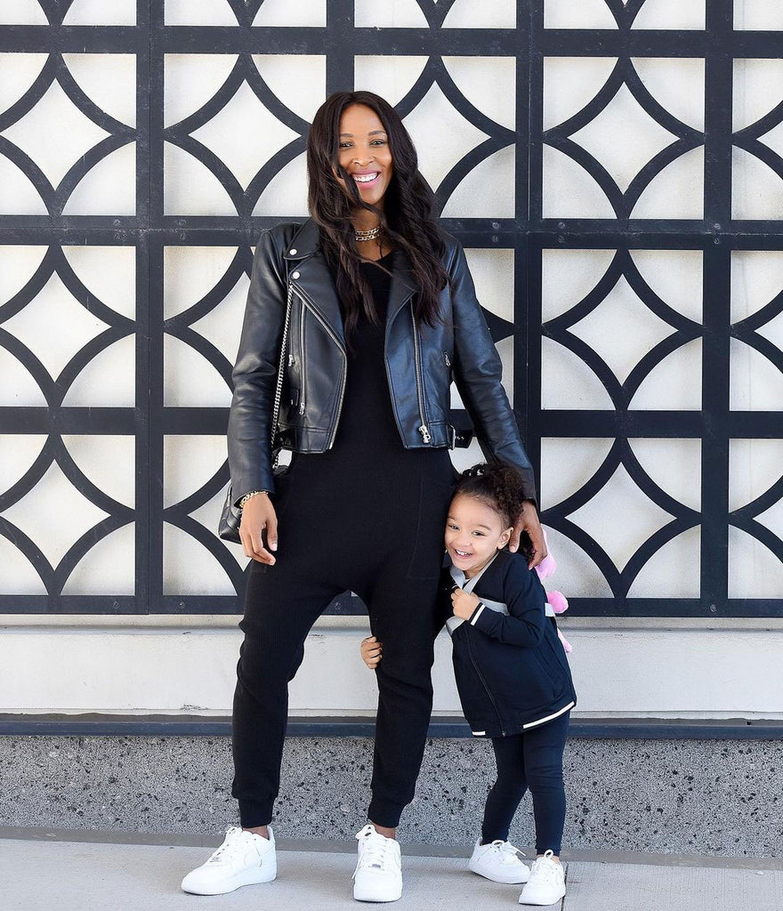 sasha exeter and child wearing black rompers and leather jacket