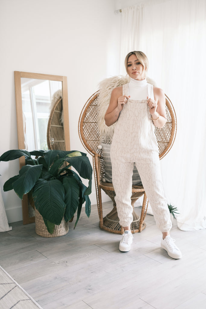 hilary duff wearing smash + Tess romperalls in front of mirror