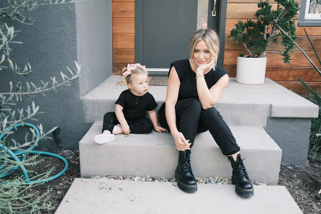 hilary duff and daughter banks sat on steps in smash + tess black rompers