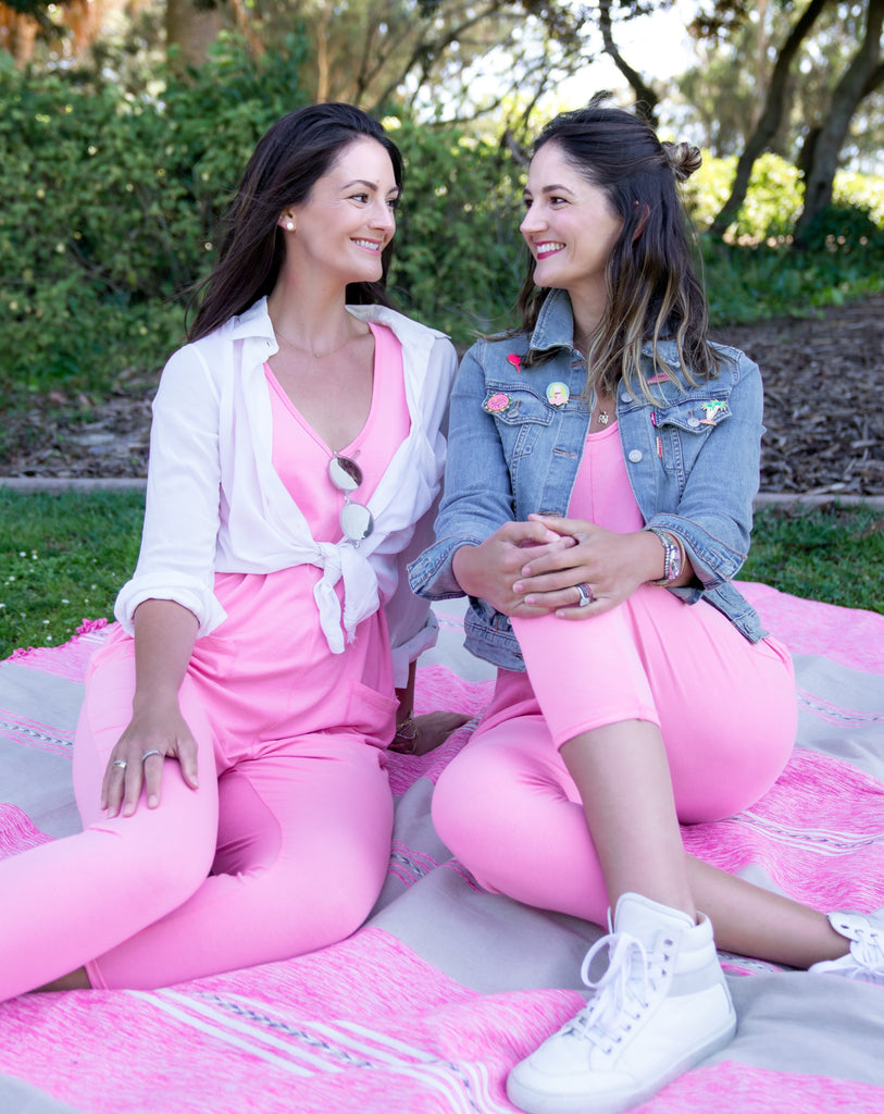 maggie and annie from benefit cosmetics wearing the saturday benebabe romper by smash + tess