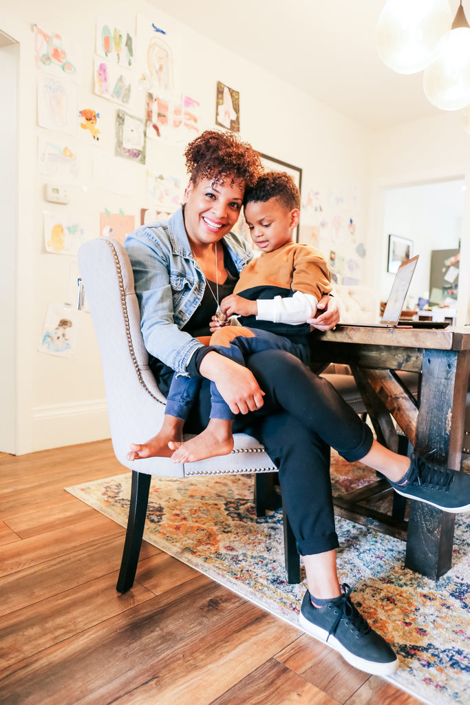 tara cauchi cco at kittys in her home office with son