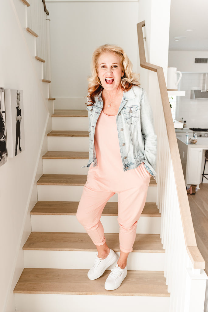 mama tess wearing the sweetheart romper in pretty pink