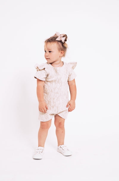The Mini Hilary Romper | Banks is wearing size 2T