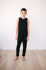 The Mini Saturday Romper, sleeveless black jumpsuit for boys | Tre is 10yrs wearing a 10/11