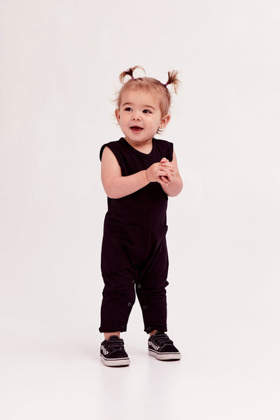 The Mini Saturday Romper, sleeveless black jumpsuit for girls | Frankie is 1.5yrs wearing 12-18M