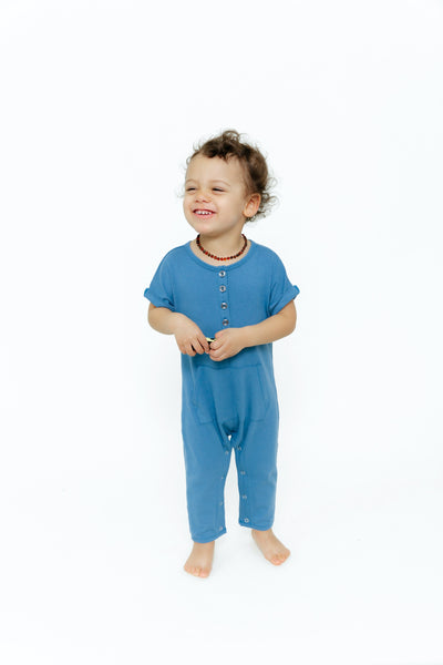 The mINI Joey Romper | Mini is wearing size 18-24M