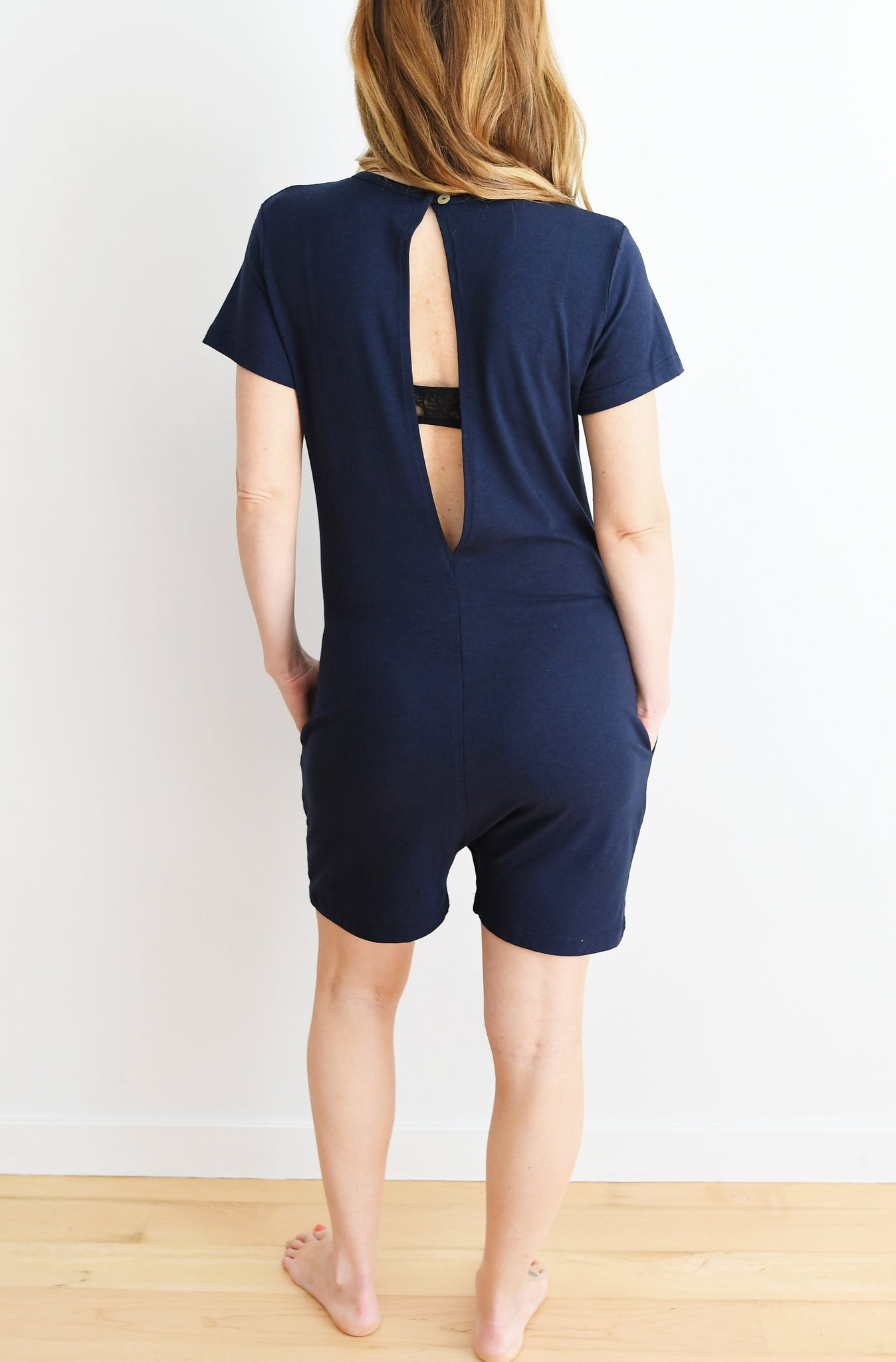 THE GETAWAY ROMPER IN NATURALLY NAVY