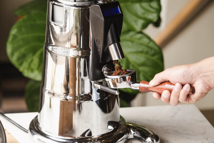The Macap M7D conical burr espresso grinder with a Clive wood portafilter - Lifestyle