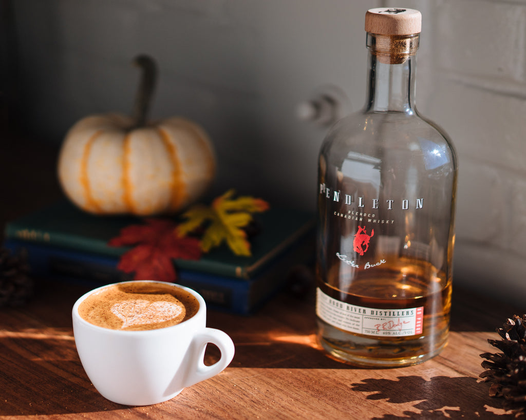 An Eggnog Cappuccino topped with nutmeg (pay no mind to the near empty bottle of Pendleton Whiskey) - Lifestyle
