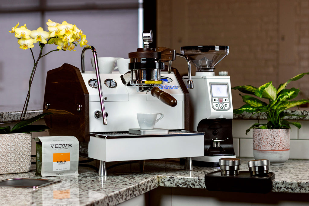 The La Marzocco GS3 MP espresso machine next to an Atom 75 espresso grinder from Eureka