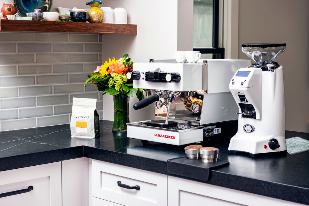 The La Marzocco Linea Mini espresso machine alongside a Eureka Zenith espresso grinder
