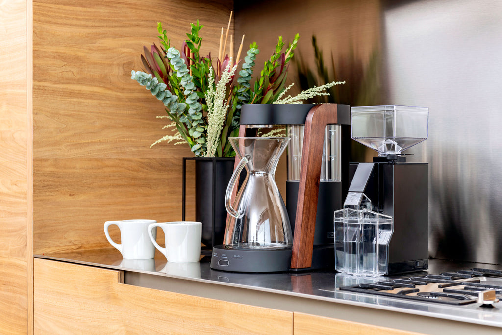 Ratio Eight coffee maker in dark cobalt with walnut accents, alongside a Eureka Mignon Filtro coffee grinder, Clive Coffee - Lifestyle