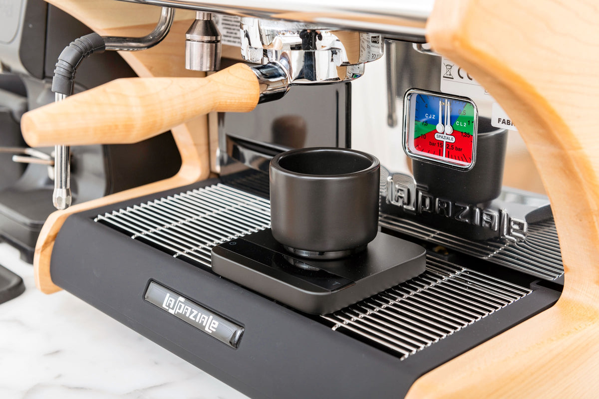 Clive Bottomless Portafilter with LUCCA A53 Mini espresso machine pulling a shot, Clive Coffee - Lifestyle