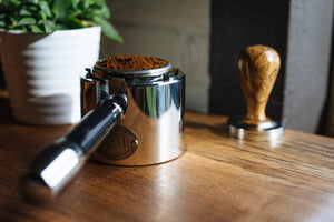 ECM Tamper Station being used with an ECM Angled Bottomless Portafilter and Clive wood tamper, Clive Coffee - Lifestyle