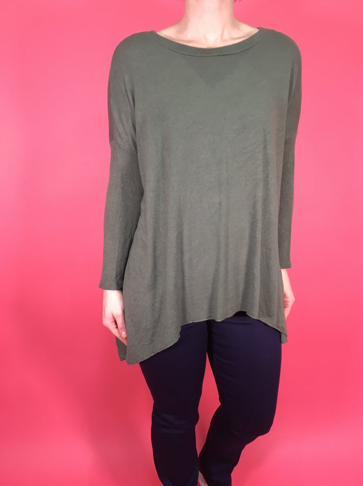 Soft touch dipped hem top