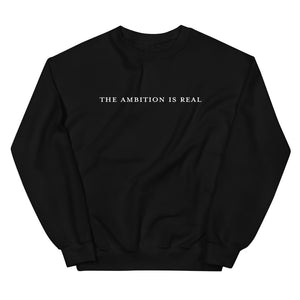 black pullover sweatshirt printed with the phrase the ambition is real on the front