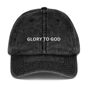 minimalist vintage black dad hat with the phrase glory to God embroidered on the front