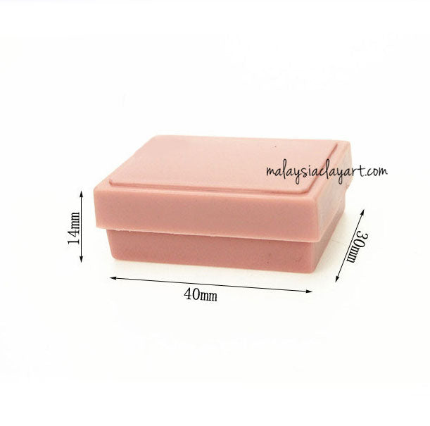 miniature light pink lunchbox bento