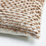 Details of the wool texture on a square pillow creme and camel
