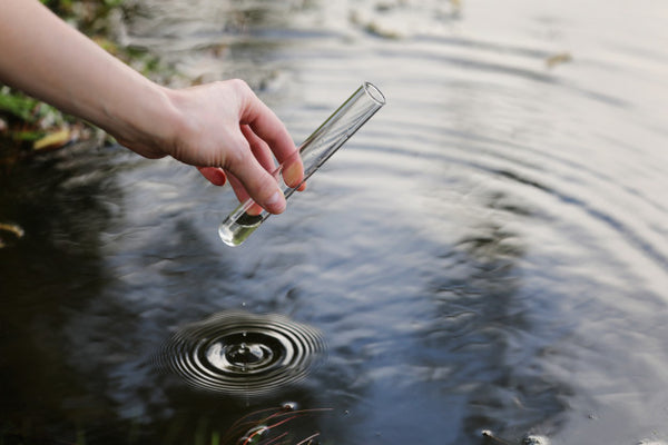 Taking-water-samples-for-PH-levels