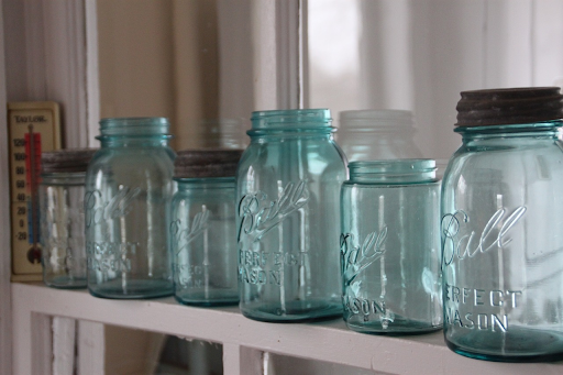 An arrangement of light blue mason jars, which can be used for the green dragon recipe.