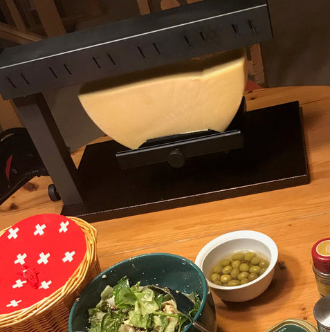Emmi Raclette Cheese under the heating element of the Raclette Melter