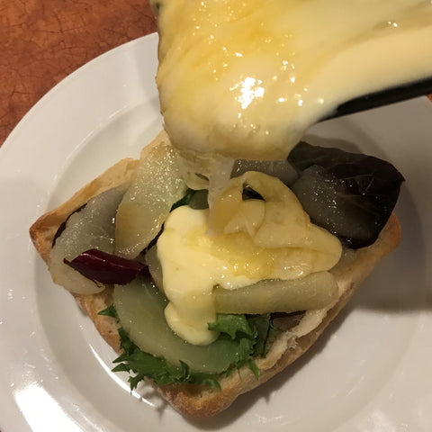 Raclette cheese is slathered onto the pear sandwich