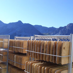 Cheese boards drying and sanitizing in the sun
